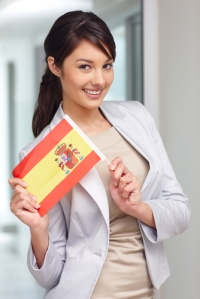 portrait_of_a_pretty_young_woman_holding_spain_s_flag